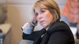 Michelle Lujan Grisham, governor of New Mexico, listens during an interview at her office in Santa Fe, New Mexico, U.S., on Thursday, Aug. 8, 2019. Lujan Grisham is balancing her concern over the catastrophic effects of climate change with the state's extraordinary dependence on oil and gas. Photographer: Steven St John/Bloomberg via Getty Images