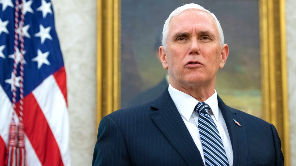 US Vice President Mike Pence speaks during an event with President Donald Trump to sign a Proclamation in honor of National Nurses Day in the Oval Office of the White House in Washington, DC, May 6, 2020.