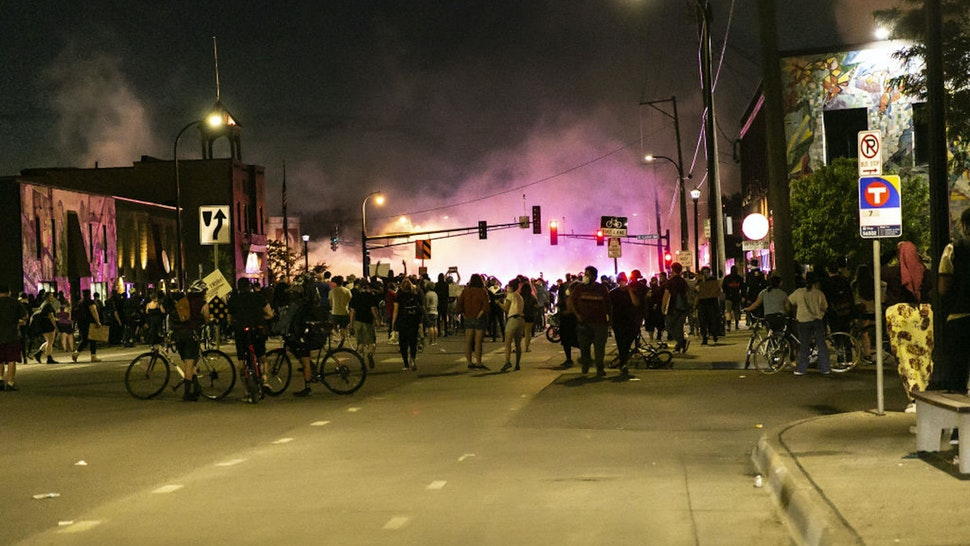 MINNEAPOLIS, USA - MAY 27: People continue the second day of protests in Minneapolis on Wednesday, May 27, 2020, over the death of George Floyd. George Floyd died in police custody in Minneapolis on Monday night, after an officer held his knee into Floyd's neck for more than 5 minutes.