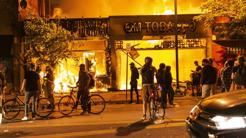 Protestors set a shop on fire on Thursday, May 28, 2020, during the third day of protests over the death of George Floyd in Minneapolis. Floyd died in police custody in Minneapolis on Monday night, after an officer held his knee into Floyd's neck for more than 5 minutes. (Photo by Jordan Strowder/Anadolu Agency via Getty Images)