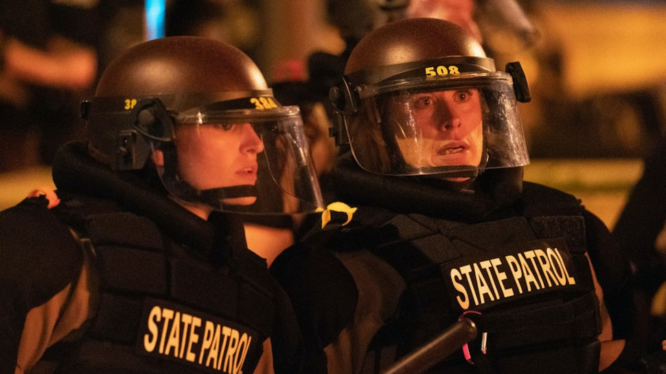Minneapolis, MN May 27: Minnesota State Patrol officers stood watch outside of the Third Precinct. Protester and police clashed violently in South Minneapolis as looters attacked business on Lake Street on Thursday, May 28, 2020 in Minneapolis. The protests were sparked by the death of George Floyd at the hands of a Minneapolis Police officer Monday.
