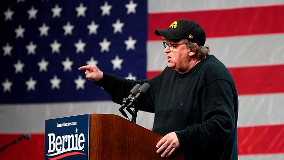 US filmmaker-author-activist Michael Moore, speaks to supporters of Democratic presidential candidate Senator Bernie Sanders at a campaign event in Clive, Iowa, on January 31, 2020.