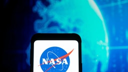 POLAND - 2020/03/23: In this photo illustration a NASA logo seen displayed on a smartphone.