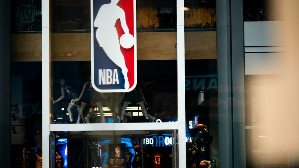 NEW YORK, NY - MARCH 12: An NBA logo is shown at the 5th Avenue NBA store on March 12, 2020 in New York City. The National Basketball Association said they would suspend all games after player Rudy Gobert of the Utah Jazz reportedly tested positive for the Coronavirus (COVID-19
