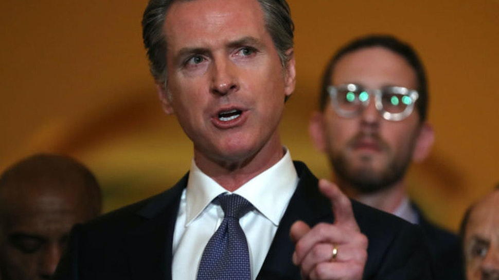 SACRAMENTO, CALIFORNIA - MARCH 13: California Gov. Gavin Newsom speaks during a news conference at the California State Capitol on March 13, 2019 in Sacramento, California. Newsom announced today a moratorium on California's death penalty. California has 737 people on death row, the largest death row population in the United States.
