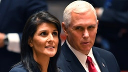 US Vice President Mike Pence (R) and Ambassador to the United Nations Nikki Haley attend a meeting of the UN Security Council on peacekeeping operations, during the 72nd session of the General Assembly in New York on September 20, 2017.