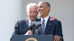U.S. President Barack Obama, right, speaks as U.S. Vice President Joe Biden stands in the Rose Garden at the White House in Washington, D.C., U.S., on Wednesday, Nov. 9, 2016. No U.S. president put more on the line than Obama to ensure the election of his chosen successor. Now, Hillary Clinton's failure may serve as a repudiation of much of his two-term legacy.