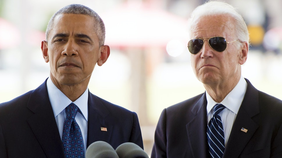 US President Barack Obama speaks alongside Vice President Joe Biden after placing flowers for the victims of the mass shooting at a gay nightclub Sunday at a memorial at the Dr. Phillips Center for the Performing Arts in Orlando, Florida, June 16, 2016.