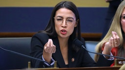 WASHINGTON, DC - OCTOBER 23: House Financial Services Committee member Rep. Alexandria Ocasio-Cortez (D-NY) questions Facebook co-founder and CEO Mark Zuckerberg with Rep. Jennifer Wexton (D-VA) during a hearing in the Rayburn House Office Building on Capitol Hill October 23, 2019 in Washington, DC. Zuckerberg testified about Facebook's proposed cryptocurrency Libra, how his company will handle false and misleading information by political leaders during the 2020 campaign and how it handles its users' data and privacy.