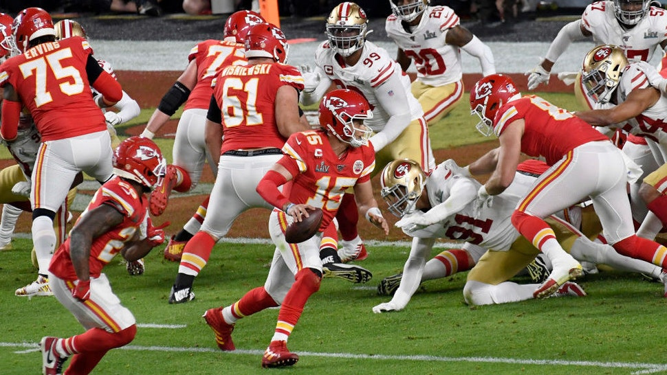 Patrick Mahomes #15 of the Kansas City Chiefs scrambles with the ball against the San Francisco 49ers in Super Bowl LIV at Hard Rock Stadium on February 02, 2020 in Miami, Florida. The Chiefs won the game 31-20. (Photo by Focus on Sport/Getty Images)