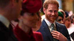 Britain's Prince Harry, Duke of Sussex (C) is introduced to performers as he leaves with Britain's Prince William, Duke of Cambridge (L) and Britain's Catherine, Duchess of Cambridge (2L) after attending the annual Commonwealth Service at Westminster Abbey in London on March 09, 2020. - Britain's Queen Elizabeth II has been the Head of the Commonwealth throughout her reign. Organised by the Royal Commonwealth Society, the Service is the largest annual inter-faith gathering in the United Kingdom.