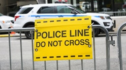 A police 'Do Not Cross' sign placed outside Trump Tower on Fifth Avenue during the coronavirus pandemic on May 2, 2020 in New York City. COVID-19 has spread to most countries around the world, claiming over 244,000 lives with over 3.4 million infections reported. (Photo by Noam Galai/Getty Images)