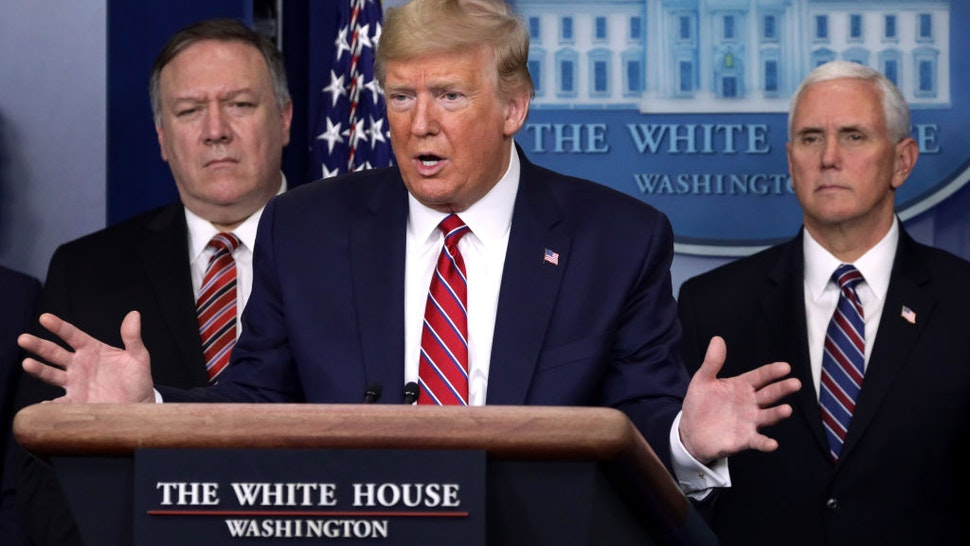 WASHINGTON, DC - MARCH 20: U.S. President Donald Trump speaks as Secretary of State Mike Pompeo and Vice President Mike Pence listen during a news briefing on the latest development of the coronavirus outbreak in the U.S. at the James Brady Press Briefing Room at the White House March 20, 2020 in Washington, DC. With deaths caused by the coronavirus rising and foreseeable economic turmoil, the Senate is working on legislation for a $1 trillion aid package to deal with the COVID-19 pandemic. President Trump announced thattax day will be delayed from April 15 to July 15. (Photo by Alex Wong/Getty Images)