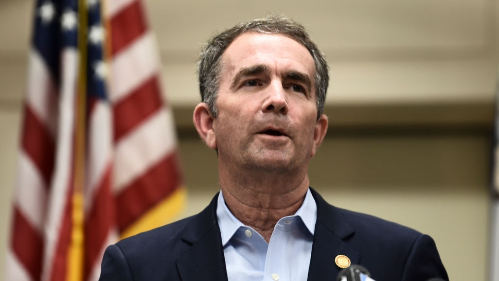 """Virginia Governor Ralph Northam speaks to the press about a mass shooting on June 1, 2019, in Virginia, Beach, Virginia. - A municipal employee sprayed gunfire """"indiscriminately"""" in a government building complex on May 31, 2019, police said, killing 12 people and wounding four in the latest mass shooting to rock the US. (Photo by Eric BARADAT / AFP) (Photo credit should read ERIC BARADAT/AFP via Getty Images)"""