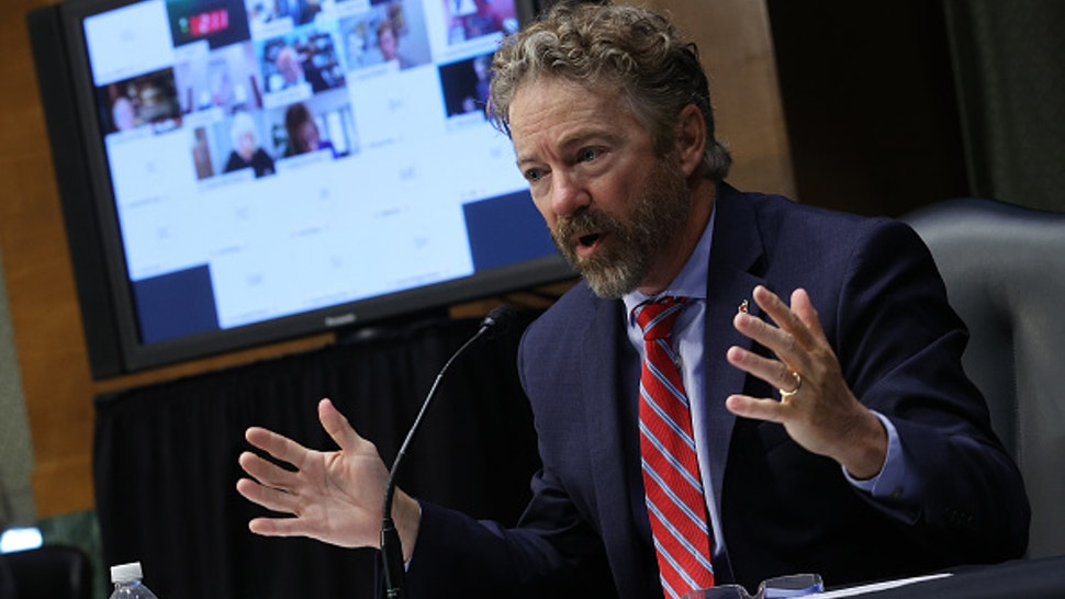 Senator Rand Paul, a Republican from Kentucky, speaks during a Senate Health, Education, Labor, and Pensions Committee hearing in Washington, D.C., U.S., on Tuesday, May 12, 2020. Amid the sharpest downturn in U.S. history, President Donald Trump has been pressing to begin relaxing the lockdowns that have shuttered businesses despite warnings from some public health experts that doing so too quickly risks a further spread of the virus. Photographer: