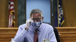 Senator Richard Burr, a Republican from North Carolina, wears a protective mask and glove while arriving to a Senate Health, Education, Labor, and Pensions Committee hearing in Washington, D.C., U.S., on Tuesday, May 12, 2020. Amid the sharpest downturn in U.S. history, President Donald Trump has been pressing to begin relaxing the lockdowns that have shuttered businesses despite warnings from some public health experts that doing so too quickly risks a further spread of the virus.