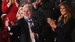 Radio personality Rush Limbaugh pumps thumb after being awarded the Medal of Freedom by First Lady Melania Trump after being acknowledged by US President Donald Trump as he delivers the State of the Union address at the US Capitol in Washington, DC, on February 4, 2020. (Photo by MANDEL NGAN / AFP)