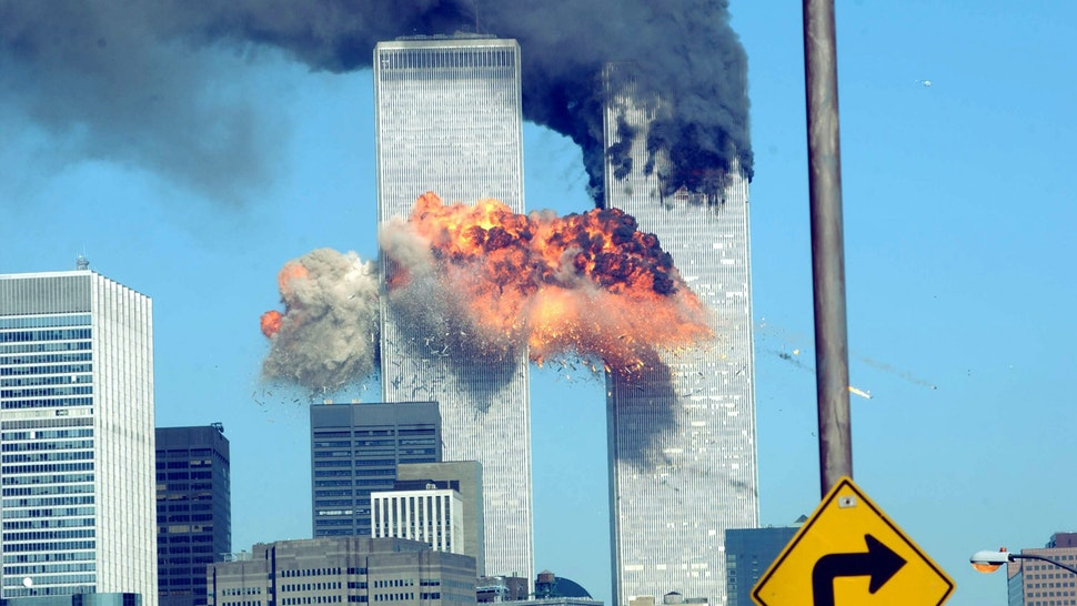 394261 14: A fiery blasts rocks the World Trade Center after being hit by two planes September 11, 2001 in New York City.