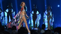 The swimsuit category during the 2019 Miss Universe pageant at the Tyler Perry Studios in Atlanta, Georgia on December 8, 2019. (Photo by VALERIE MACON / AFP)