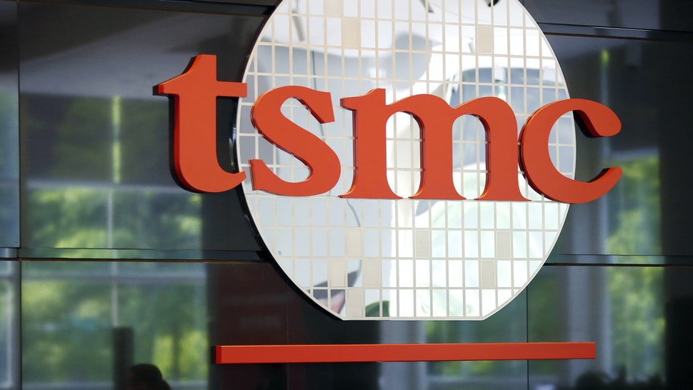 Signage for Taiwan Semiconductor Manufacturing Co. (TSMC) is displayed at the company's headquarters in Hsinchu, Taiwan, on Wednesday, June 5, 2019. TSMC Chairman Mark Liudidn't reaffirm a previous forecast that the company will grow slightly in 2019, saying uncertainty was too great at the moment.