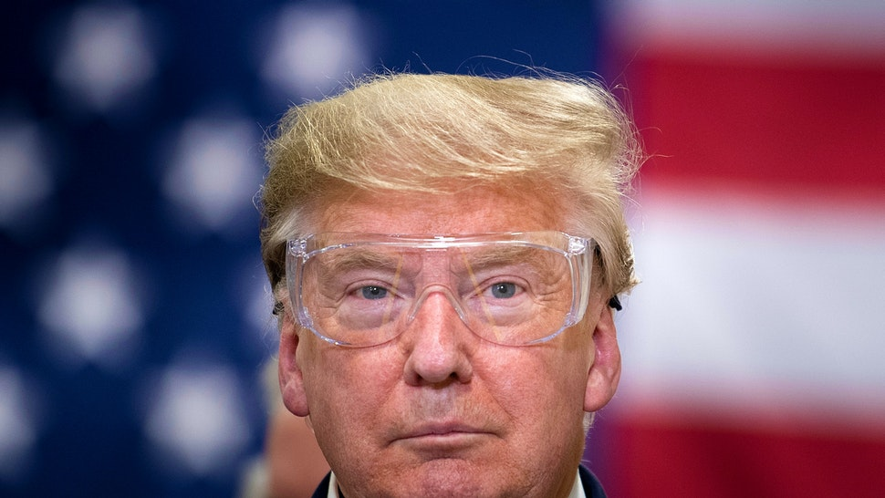 US President Donald Trump tours a Honeywell International Inc. factory producing N95 masks during his first trip since widespread COVID-19 related lockdowns went into effect May 5, 2020, in Phoenix, Arizona.
