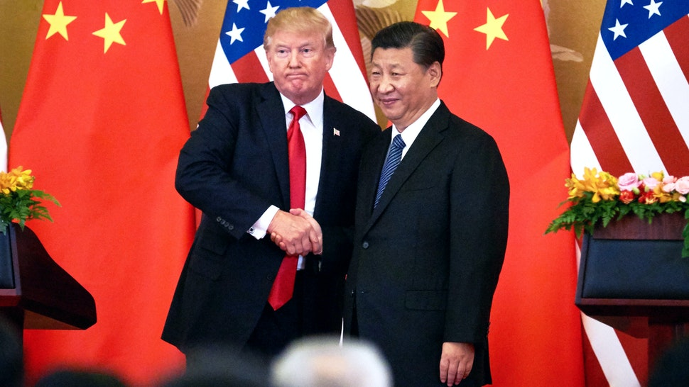 BEIJING, CHINA - NOVEMBER 9, 2017: US President Donald Trump (L) and China's President Xi Jinping shake hands at a press conference following their meeting at the Great Hall of the People in Beijing.