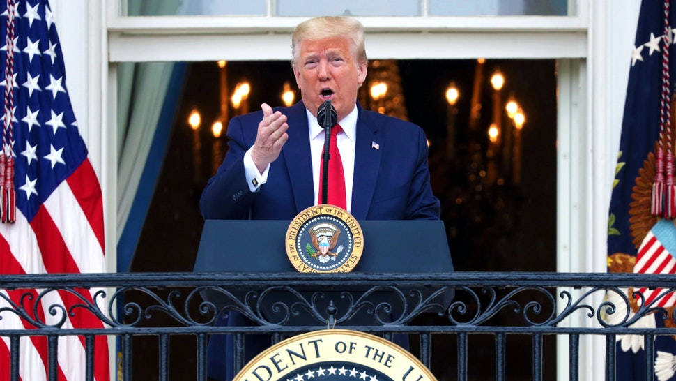 WASHINGTON, DC - MAY 22: U.S. President Donald Trump speaks from the Truman Balcony during a Rolling to Remember Ceremony: Honoring Our Nation's Veterans and POW/MIA at the White House May 22, 2020 in Washington, DC. President Trump hosted the event to honor America's veterans and fallen heroes.