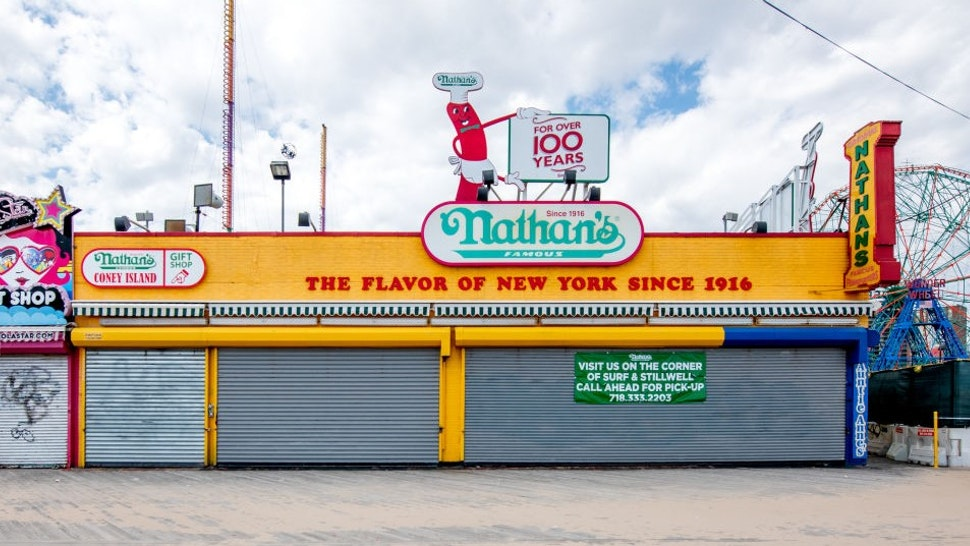 NEW YORK, NEW YORK - MAY 04: The Nathan's Famous beach storefront at Riegelmann Boardwalk in Coney Island is closed during the coronavirus pandemic on May 04, 2020 in New York City. COVID-19 has spread to most countries around the world, claiming over 252,000 lives with over 3.6 million infections reported. (Photo by