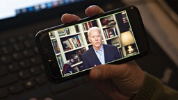 Former Vice President Joe Biden, 2020 Democratic presidential candidate, speaks during a virtual press briefing on a smartphone in this arranged photograph in Arlington, Virginia, U.S., on Wednesday, March 25, 2020. During the livestreamed news conference today, Biden said he didn't see the need for another debate, which the Democratic National Committee had previously said would happen sometime in April. Photographer: