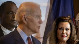 Former Vice President Joe Biden speaks as Michigan Governor Gretchen Whitmer looks on at an event at Cherry Health in Grand Rapids, MI on March 9, 2020. (Photo by