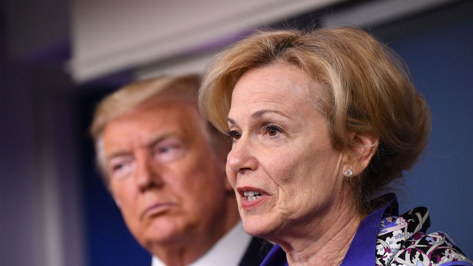 Deborah Birx, coronavirus response coordinator, speaks while U.S. President Donald Trump, left, listens during a Coronavirus Task Force news conference in the briefing room of the White House in Washington, D.C., U.S., on Wednesday, March 18, 2020. Trump invoked the Defense Production Act, allowing the government to boost production of masks and protective equipment. Europe surpassed China in the number of coronavirus infections. Photographer: