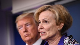 Deborah Birx, coronavirus response coordinator, speaks while U.S. President Donald Trump, left, listens during a Coronavirus Task Force news conference in the briefing room of the White House in Washington, D.C., U.S., on Wednesday, March 18, 2020. Trumpinvoked the Defense Production Act, allowing the government to boost production of masks and protective equipment. Europe surpassed China in the number of coronavirus infections. Photographer: