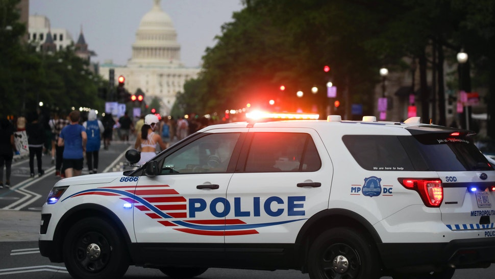 "WASHINGTON, USA - MAY 29: A police car is seen as hundreds of demonstrators rally hours after the arrest of a white police officer involved in the death of a black man George Floyd in the state of Minnesota on May 29, 2020 in Washington D.C. United States. Floyd, 46, a black man, was arrested Monday after reportedly attempting to use a counterfeit $20 bill at a local store. Video footage on Facebook showed him handcuffed and cooperating. But police claimed he resisted arrest. A white officer kneeled on his neck, despite Floydâs repeated pleas of ""I can't breathe."" Former police officer Derek Chauvin was charged with third-degree murder and manslaughter, according to Hennepin County Prosecutor Michael Freeman. Minneapolis, Minnesota Mayor Jacob Frey said Friday he imposed a mandatory curfew because of ongoing protests regarding the death of George Floyd. Protestors made their way to the White House where they faced a police response with some clashing with the secret service members."