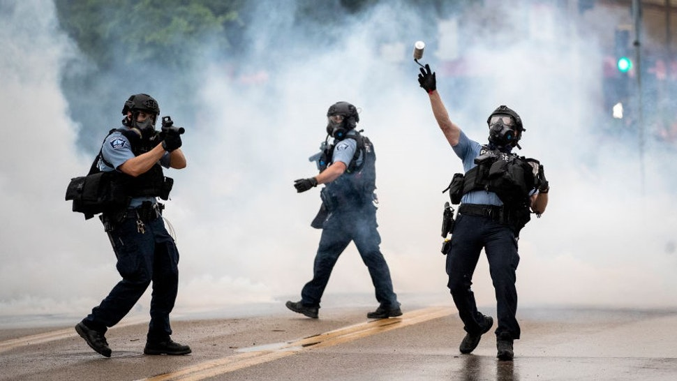 MINNEAPOLIS, MN,- MAY 26: Police clashed with protesters at the Minneapolis 3rd Police Precinct. People gathered at Chicago Ave. and East 38th Street during a rally in Minneapolis on Tuesday, May 26, 2020. Federal authorities are investigating a white Minneapolis police officer for possible civil rights violations, after a video surface showing him kneeling on a handcuffed African-American man's neck and ignoring the man's protests that he couldn't breathe. The man later died. An attorney for the man's family identified him as George Floyd. (Photo by