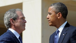 US President Barack Obama (R) and former President George W. Bush shakes hands during the opening ceremony of the George W. Bush Presidential Center April 25, 2013 on the campus of Southern Methodist University (SMU)in Dallas, Texas. AFP PHOTO/Jewel Samad (Photo credit should read