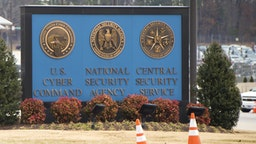 A sign for the National Security Agency (NSA), US Cyber Command and Central Security Service, is seen near the visitor's entrance to the headquarters of the National Security Agency (NSA) after a shooting incident at the entrance in Fort Meade, Maryland, February 14, 2018.