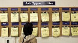 OAKLAND, CA - FEBRUARY 02: A job seeker looks at a job listing board at the East Bay Career Center February 2, 2006 in Oakland, California. According to a government report, U.S. unemployment benefits claims dropped to about 273,000 last week, sending a four-week average of claims to the lowest level in nearly six years. (Photo by