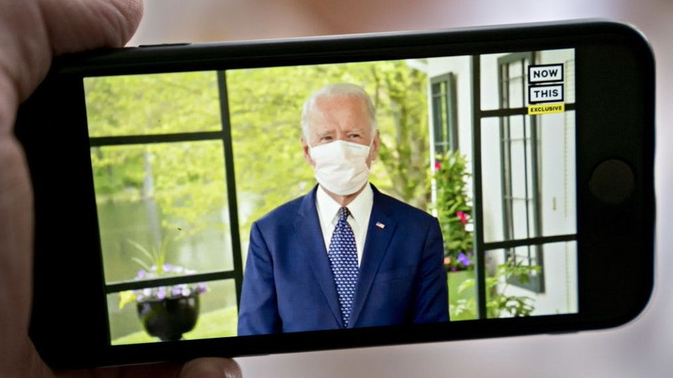 Former Vice President Joe Biden, presumptive Democratic presidential nominee, wears a protective mask during a NowThis economic address seen on a smartphone in Arlington, Virginia, U.S., on Friday, May 8, 2020. A super political action committee backing Joe Biden will launch a $10 million television ad campaign touting the presumptive Democratic nominee's leadership on the economic recovery after the 2008 financial crisis. Photographer: