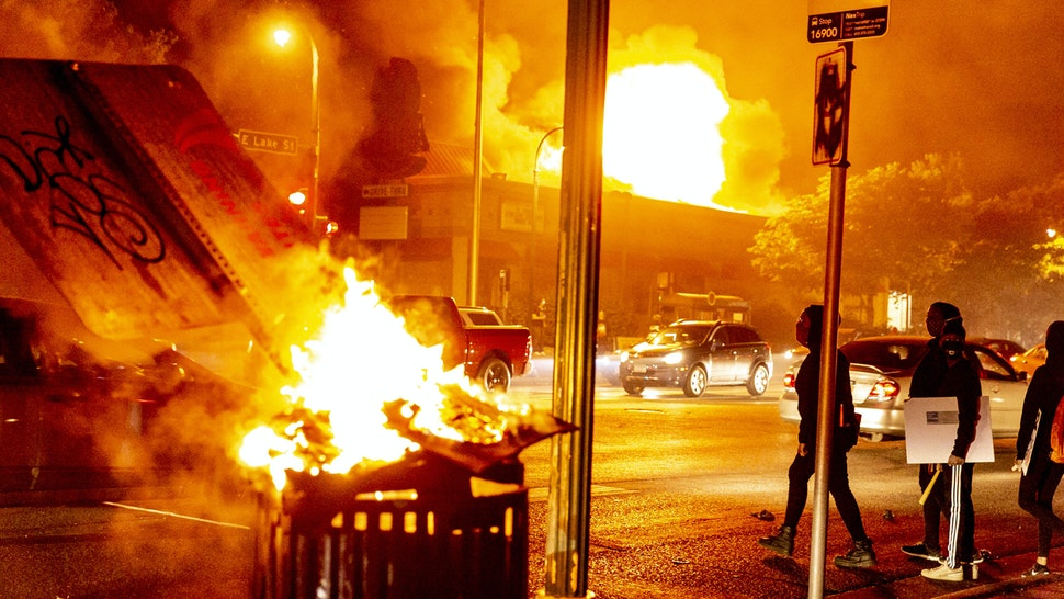 MINNESOTA, USA - MAY 28: Protestors set a shop on fire on Thursday, May 28, 2020, during the third day of protests over the death of George Floyd