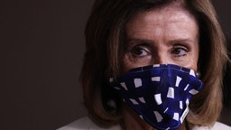 WASHINGTON, DC - APRIL 30: Speaker of the House Nancy Pelosi (D-CA) wears a cloth mask to cover her mouth and nose to prevent the spread of the novel coronavirus during her weekly news conference at the U.S. Capitol April 30, 2020 in Washington, DC. While she and Democratic House leaders are not going to reconvene next week due to the COVID-19 pandemic, she said committee chairs are working on the next piece of economic rescue legislation. (Photo b