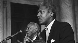 "Bayard Rustin, Executive Director of the A. Phillip Randolph Institute, urged action on the ""freedom budget' developed by the Institute which would guarantee an Annual wage for poor people."