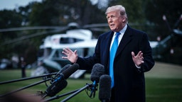 US President Donald Trump speaks to the media as he prepares to board Marine One on the South Lawn of the White House on October 26, 2018 in Washington, DC. Trump was traveling to a rally in Charlotte, NC.
