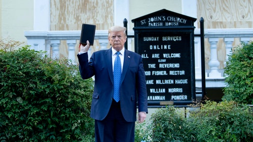 US President Donald Trump holds a Bible while visiting St. John's Church across from the White House after the area was cleared of people protesting the death of George Floyd June 1, 2020, in Washington, DC.