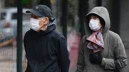 People wear face masks on April 03, 2020 in New York.
