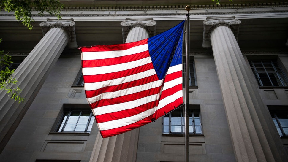 An American flag is displayed on the Pennsylvania Avenue side of the Department of Justice on Wednesday, June 3, 2020.(Photo By Tom Williams/CQ-Roll Call, Inc via Getty Images)