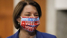 Senator Amy Klobuchar, a Democrat from Minnesota, wears a protective mask while arriving to a Senate Judiciary Committee executive business meeting in Washington, D.C., U.S., on Thursday, June 11, 2020. The committee is scheduled to authorize subpoenas of numerous former Obama-era officials while reviewing the origins of the investigation into Russian election interference and the Trump campaign's role. Photographer: Carolyn Kaster/AP Photo/Bloomberg via Getty Images