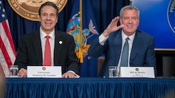 "NEW YORK, NY - MARCH 2: New York state Gov. Andrew Cuomo and New York City Mayor Bill DeBlasio speak during a news conference on the first confirmed case of COVID-19 in New York on March 2, 2020 in New York City. A female health worker in her 30s who had traveled in Iran contracted the virus and is now isolated at home with symptoms of COVID-19, but is not in serious condition. Cuomo said in a statement that the patient ""has been in a controlled situation since arriving to New York."" (Photo by David Dee Delgado/Getty Images)"
