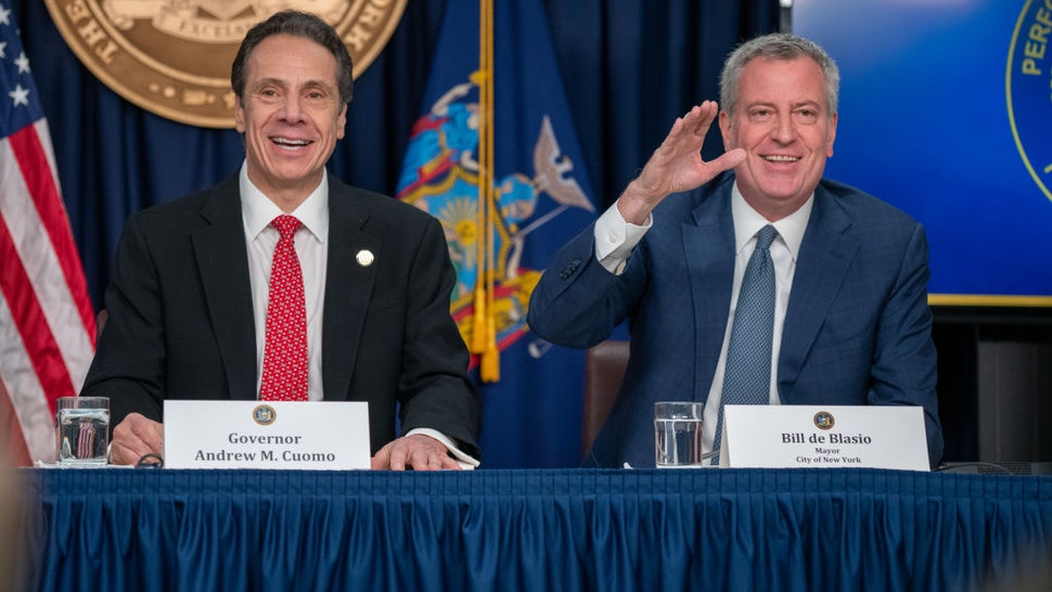 """NEW YORK, NY - MARCH 2: New York state Gov. Andrew Cuomo and New York City Mayor Bill DeBlasio speak during a news conference on the first confirmed case of COVID-19 in New York on March 2, 2020 in New York City. A female health worker in her 30s who had traveled in Iran contracted the virus and is now isolated at home with symptoms of COVID-19, but is not in serious condition. Cuomo said in a statement that the patient """"has been in a controlled situation since arriving to New York."""" (Photo by David Dee Delgado/Getty Images)"""