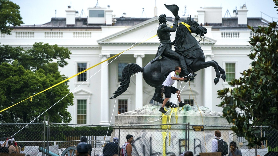 WASHINGTON, DC - JUNE 22: Protesters attempt to pull down the statue of Andrew Jackson in Lafayette Square near the White House on June 22, 2020 in Washington, DC. Protests continue around the country over police brutality, racial injustice and the deaths of African Americans while in police custody.