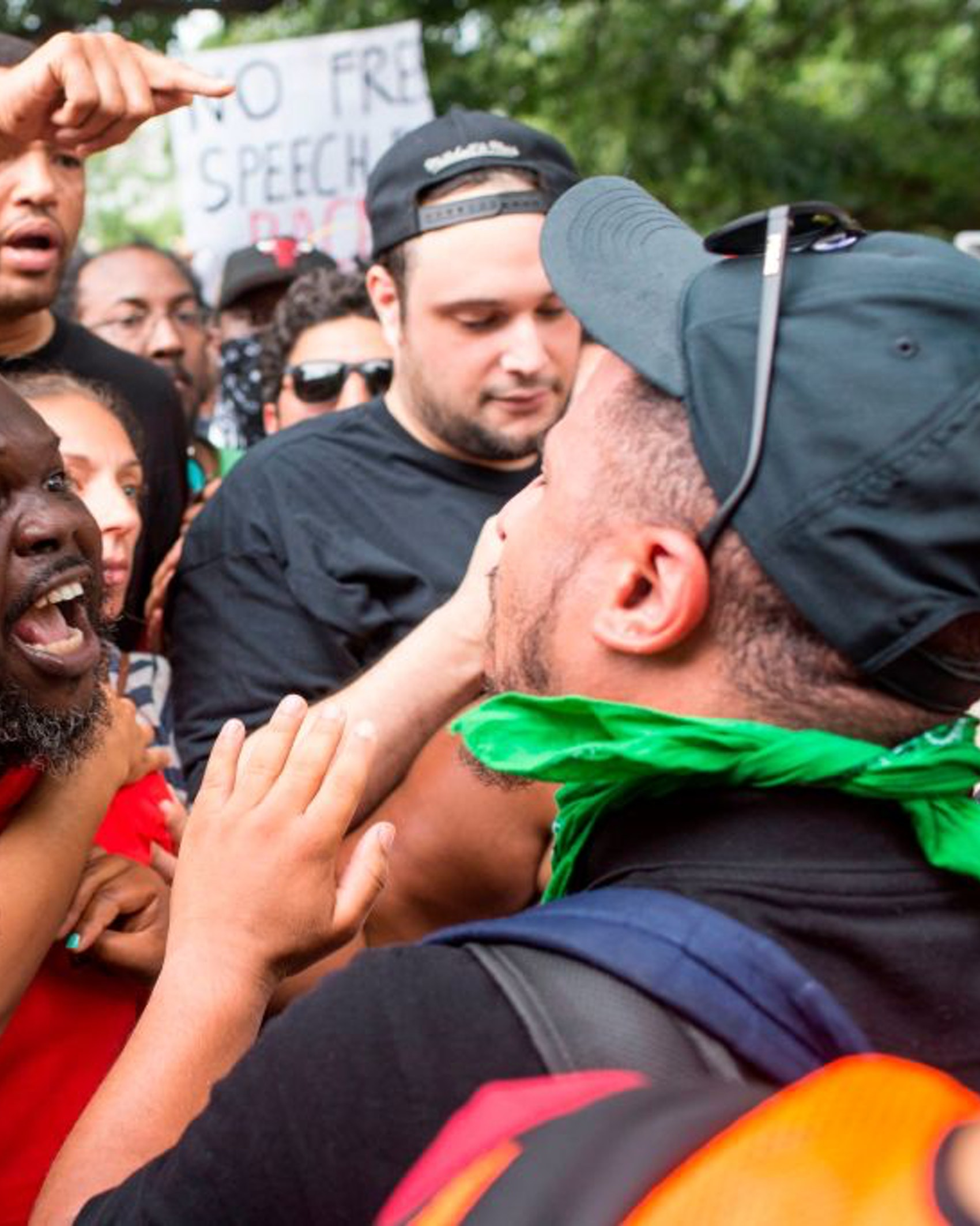 TOPSHOT - Antifa and counter protestors to a far-right rally argue during the Unite the Right 2 Rally in Washington, DC, on August 12, 2018. - Last year's protests in Charlottesville, Virginia, that left one person dead and dozens injured, saw hundreds of neo-Nazi sympathizers, accompanied by rifle-carrying men, yelling white nationalist slogans and wielding flaming torches in scenes eerily reminiscent of racist rallies held in America's South before the Civil Rights movement. (Photo by ZACH GIBSON / AFP) (Photo credit should read ZACH GIBSON/AFP via Getty Images)